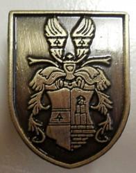 Odlievaný odznak s motívom občianskeho znaku