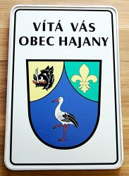 Uvítacia tabula so znakom a názvom obce, sendvičový plech