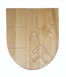 Vyrezávaný znak so symbolmi obce, mesta, predmestia